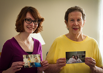 Estelle Rosen and Chelsea Shea with photos from their tutoring sessions 19 years ago